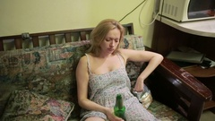 Female alcoholic dependence, woman with a bottle in hands. Stock Footage