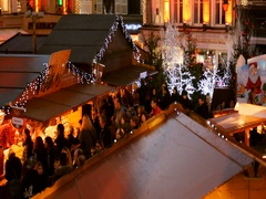Aerial of Christmas Market - crowd visiting Christmas chalets Stock Footage