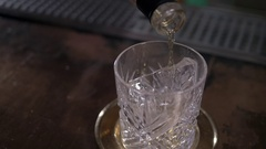 Pouring a whiskey cocktail into glass, close up. Alcohol pouring Stock Footage
