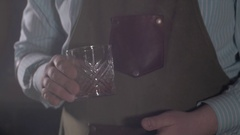 Bartender prepare Old fashion coctail in modern bar. Barmen stirring and pouring Stock Footage
