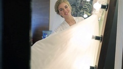 Happy bride posing with wedding dress smiling touching and straighten it light Stock Footage