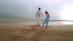 Couple draw heart symbol on sand. Romantic couple drawing heart shape on beach Stock Footage