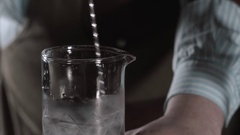 Bartender is stirring cocktails on the bar counter no face Stock Footage