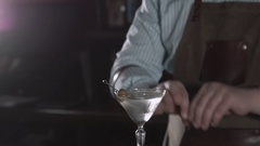 Barman at work, preparing cocktails. Pouring margarita to cocktail glass Stock Footage