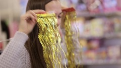 Mother and daughter having fun with decorate for xmas tree at supermarket. Stock Footage