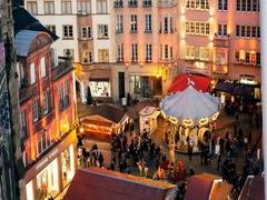 Aerial of Christmas Market with carousel in French central place city Stock Footage