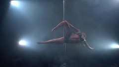 Pole dance in studio. View of professional dancer Stock Footage