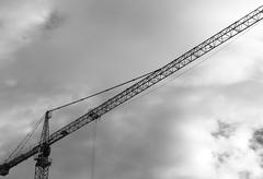 Industrial crane black and white background Stock Photos
