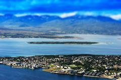 Tilt-shifted micro toy Tromso city background Stock Photos