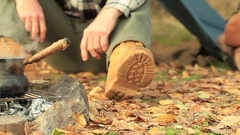 Camp of man  tourist. Coffee, bonfire, guitar and autumn leaves. Vintage shoot. Stock Footage