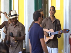 Close-up view men musicians sing salsa melody and play maracas, guitar near Stock Footage