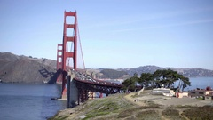 Cars driving over the Golden Gate Bridge with water beneath in San Francisco Stock Footage