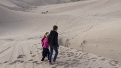 Children playing in sand dunes HD Stock Footage