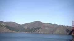 Panning across mountains to Golden Gate Bridge cars driving across San Francisco Stock Footage