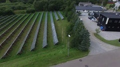 Aerial of private solar power panels in Denmark Stock Footage