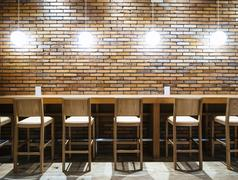 Table counter Bar Seats stool and Lights with Brick wall background Stock Photos