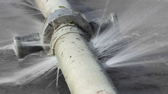 Water leaking from hole in a hose Stock Footage