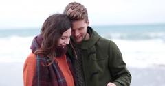Couple taking selfie on beach in Winter Stock Footage