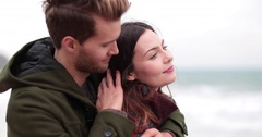 Couple on beach in Winter Stock Footage