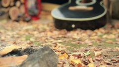 Camp of  tourist. Hot Coffee, bonfire, guitar and autumn leaves. Vintage shoot. Stock Footage
