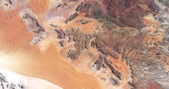 High-altitude overflight aerial of rocky terrain in the Namib desert. Stock Footage