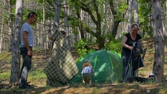 Mom and Dad collected a tent. Kids in the woods Stock Footage