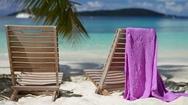 Beach Charis and sarong at Salomon Bay beach, St John Stock Footage