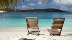 Beach chairs at Salomon Bay, St John, United States Virgin Islands Stock Footage