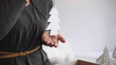 Woman packs gifts for new year, decorations for the christmas tree,christmas Stock Footage