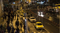 Flow of  taxi and passengers on terminal square, time lapse Stock Footage