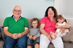 Grandparents And Grandchildren Wearing Glasses Stock Photos