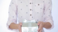 Girl gives a gift in the box. Stock Footage