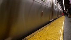 Metro train getting in subway station Stock Footage