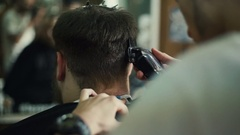 Hairdresser makes hairstyle a man with a beard Stock Footage