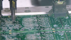 SMT machine manufacturing electronic board at high speed Stock Footage