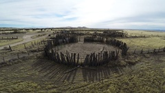 Aerial-Flying over old historic pioneer corrals, sheds and homestead Stock Footage