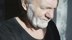 Old man shaving beard at home by himself in 4K Stock Footage