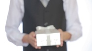 Man gives a gift in the box Stock Footage