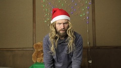 Evil dwarf or bad santa holding a gift in celebratory packing Stock Footage