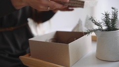 Woman packs gifts for new year, christmas presents for children, souvenirs and Stock Footage