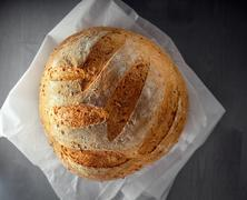 Multi grain bread on a wooden table. Stock Photos