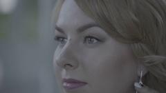 Cute young blonde woman in lingerie wearing earrings Flat Stock Footage