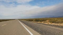 POV-Driving New Mexico desert highway near Mexico border Stock Footage