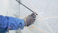 Graffiti artist painting on the wall, exterior, close up Stock Footage