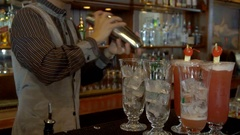 Barmen preparing singapore sling cocktail Stock Footage