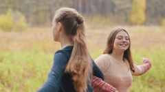 Two beutiful girls dancing. They laughing and spin around Stock Footage