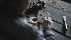 The old man hewing wooden tools in workshop 4K Stock Footage
