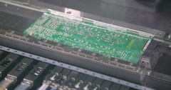 SMT machine placing elements on circuit board Stock Footage