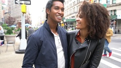 Ethnic couple walking in New york city street Stock Footage