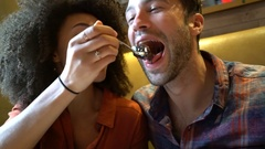 Couple in restaurant eating chocolate cake Stock Footage